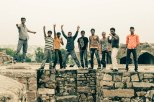 A gang of young indian men: ready to assault for photos on their cameraphones