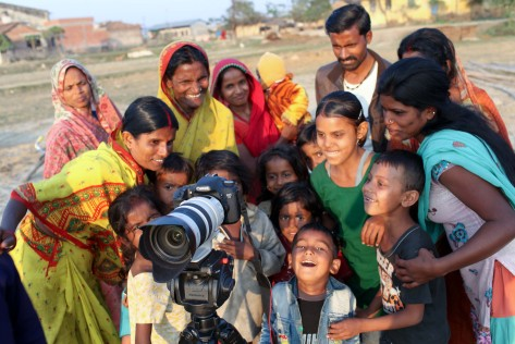 Villagers gathered round the Camera
