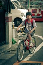 Adidas boy on a bike